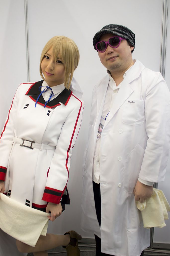 Two masseuses from the Infinite Stratos 2 booth.
